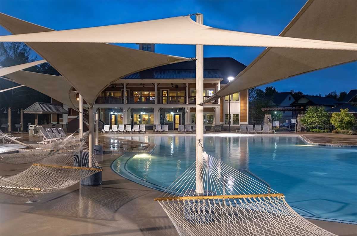 College Town Oxford Outdoor Pool Hammocks at Night